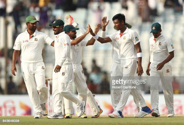 Mustafizur Rahman of Bangladesh celebrates after taking the wicket of David Warner of Australia during day four of the Second Test match between...