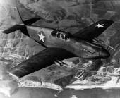 Mustang fighter plane flies over a coastline The P51 was renowned for its superiority over German war planes In addition to its extra fuel capacity...