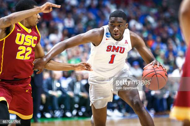 Mustangs guard Shake Milton drives to the basket as USC Trojans guard De'Anthony Melton defends during the NCAA Tournament first round game game...