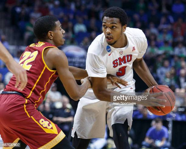 Mustangs guard Sterling Brown looks for an open teammate as USC Trojans guard De'Anthony Melton defends during the NCAA Tournament first round game...