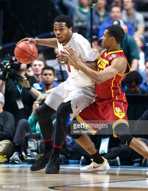 Mustangs guard Sterling Brown posts up on USC Trojans guard De'Anthony Melton during the NCAA Tournament first round game game between the SMU...