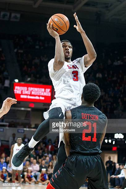 Mustangs guard Sterling Brown shoots over Houston Cougars guard Damyean Dotson during the American Athletic Conference college basketball game...