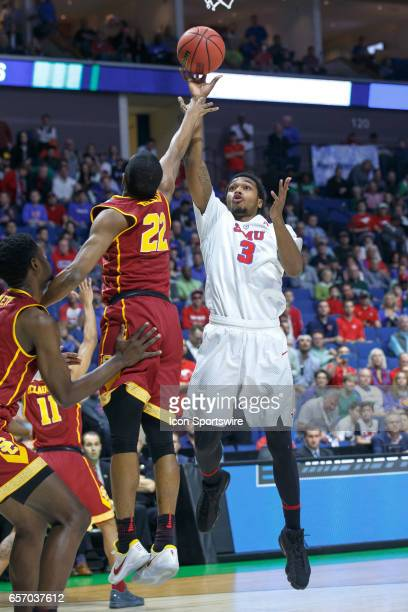 Mustangs guard Sterling Brown shoots over USC Trojans guard De'Anthony Melton during the NCAA Tournament first round game game between the SMU...