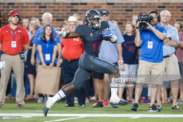 Mustangs running back KeMon Feeman breaks down the sideline for a touchdown during the college football game between the SMU Mustangs and the...