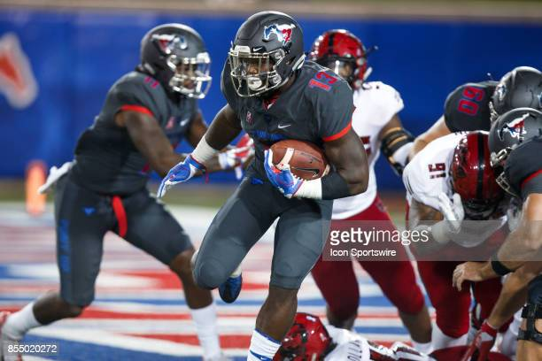 Mustangs running back KeMon Feeman breaks through a hole in the line during the college football game between the SMU Mustangs and the Arkansas State...