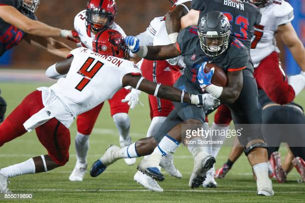 Mustangs running back KeMon Feeman breaks through the tackle of Arkansas State Red Wolves safety Michael Johnson during the college football game...