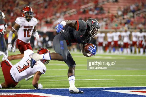 Mustangs running back Ke'Mon Freeman scores a touchdown during a football game against the Arkansas State Red Wolves on September 23 2017 at Gerald J...