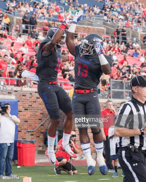 Mustangs wide receiver Courtland Sutton and SMU Mustangs running back KeMon Feeman celebrate a touchdown during the college football game between the...