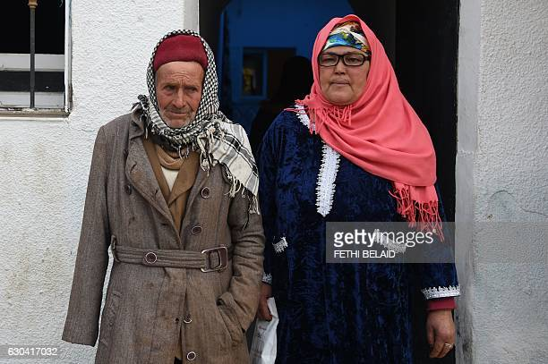 Mustapha and NourHouda Amri the parents of 24yearold Anis Amri the prime suspect in Berlin's deadly truck attack pose in front their house in the...