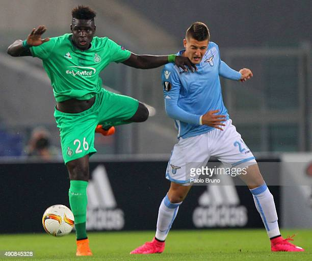 Mustapha Bayal Sall of AS SaintEtienne competes for the ball with Sergej MilinkovicSavic of SS Lazio during the UEFA Europa League group G match...