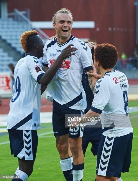 Mustapha Bundu Mustafa Amini and Pierre Kanstrup of AGF Aarhus celebrate after the Danish Alka Superliga match between AGF Aarhus and Hobro IK at...