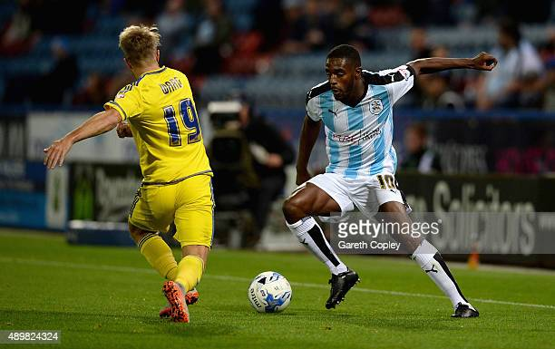 Mustapha Carayol of Huddersfield Town looks to get past Jamie Ward of Nottingham Forest during the Sky Bet Championship match between Huddersfield...