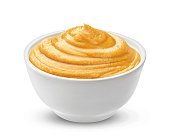 Mustard in bowl isolated on white background with clipping path, one of the collection of various sauces