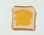 Mustard spread on a white bread