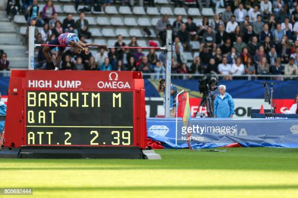 Mutaz Barshim of Katar competes in the high jump event within the International Association of Athletics Federations Diamond League in Paris France...