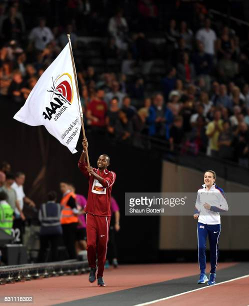 Mutaz Essa Barshim of Qatar and Laura Muir of Great Britain participate in the handover ceremony during day ten of the 16th IAAF World Athletics...