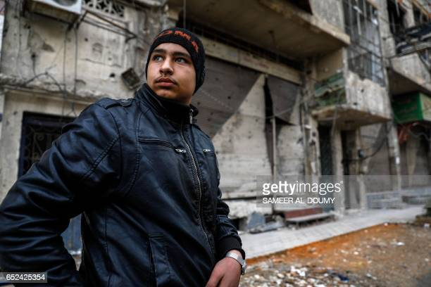 Mute 17yearold Syrian Adnan who lost both legs in 2014 following an airstrike as he was walking towards his father's shop from school walks past the...