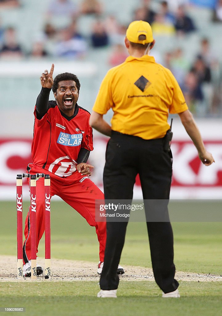 Muthiah Muralidaran of the Melbourne Renegades dismisses <a gi-track='captionPersonalityLinkClicked' href=/galleries/search?phrase=Cameron+White&family=editorial&specificpeople=178931 ng-click='$event.stopPropagation()'>Cameron White</a> of the Melbourne Stars during the Big Bash League match between the Melbourne Stars and the Melbourne Renegades at Melbourne Cricket Ground on January 6, 2013 in Melbourne, Australia.