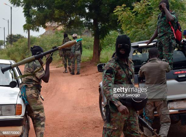 Mutinous soldiers hold an RPG rocket launcher inside a military camp in Ivory Coast's central second city Bouake on May 15 2017 Gunshots rang out...