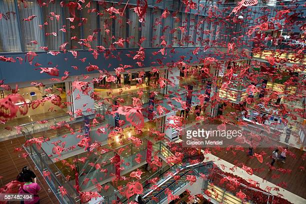 A mutitdue of red paper butterflies decorate the top storey of Joy City the newest shopping mall to open in Xidan the main shopping district in...