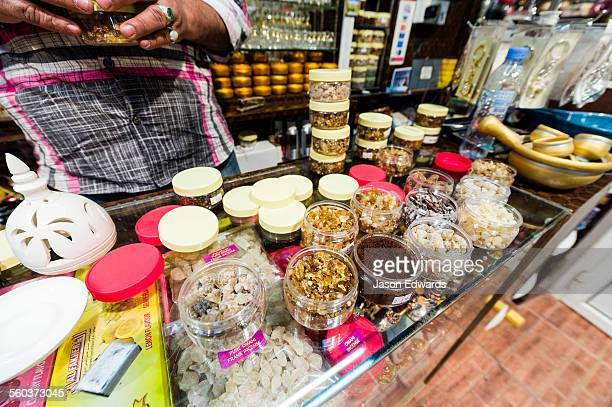 A shop in a market displays and sells varieties of aromatic frakincense.
