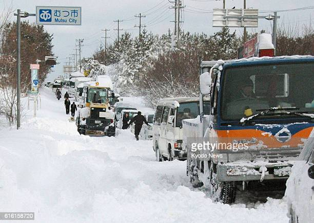 Mutsu Japan Photo shows vehicles stranded in heavy snow on Route 279 in Aomori Prefecture northeastern Japan at 815 am on Feb 2 2012