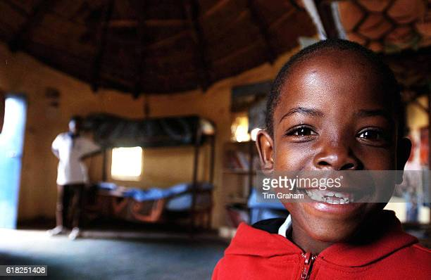 Mutsu Potsane in his bedroom at the Mants'ase children's home to meet Prince Harry on a visit to launch his new charity 'Sentebale' which means...