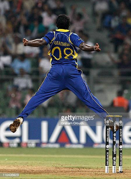 Muttiah Muralidaran of Sri Lanka jumps high despite a strained hamstring to catch Scott Styris of New Zealand off his own bowling during the Group A...