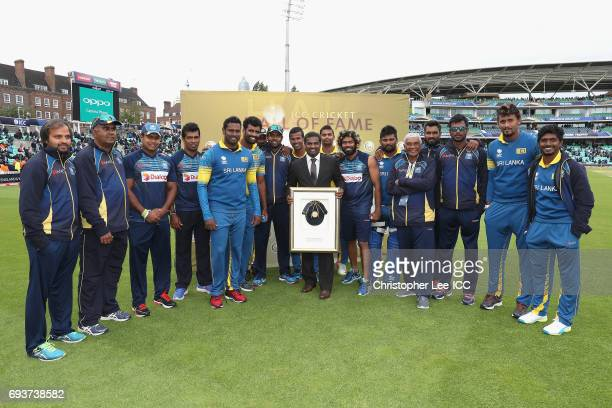 Muttiah Muralidaran of Sri Lanka with his Hall of Fame Cap and the Sri Lanka team during the ICC Champions Trophy Group B match between India and Sri...