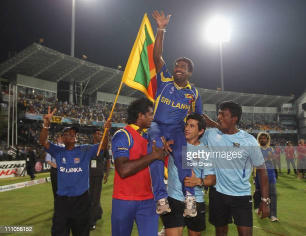 Muttiah Muralitharan of Sri Lanka acknowledges the crowd after playing his last match in Sri Lanka during the 2011 ICC World Cup SemiFinal match...
