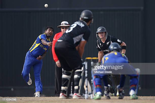 Muttiah Muralitharan of Sri Lanka bowls to Ross Taylor during the 2011 ICC World Cup SemiFinal match between New Zealand and Sri Lanka at the R...