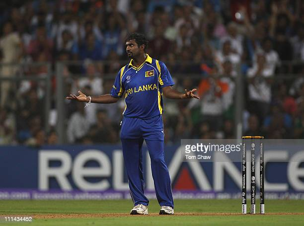 Muttiah Muralitharan of Sri Lanka gestures after a fielding mistake during the 2011 ICC World Cup Final between India and Sri Lanka at the Wankhede...