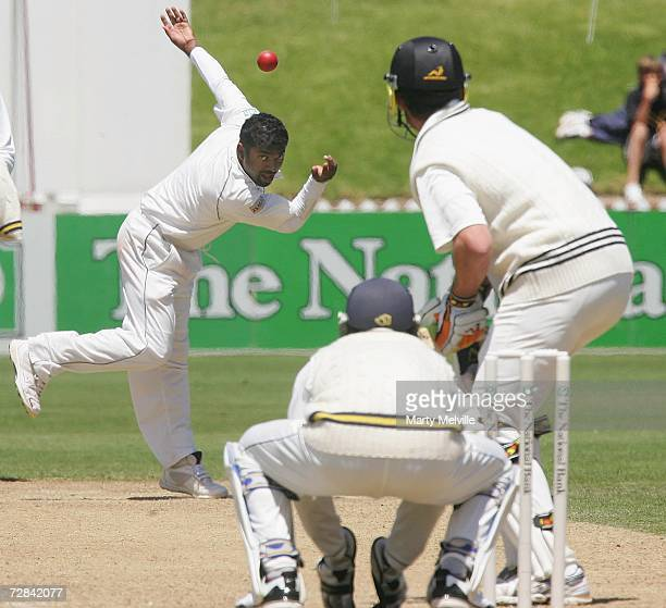 Muttiah Muralitharan of Sri Lanka in action against James Franklin of New Zealand during day four of the second test match between New Zealand and...