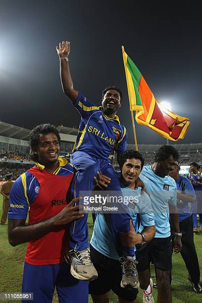 Muttiah Muralitharan of Sri Lanka is hoisted high by Dilhara Fernando and physio Tommy Simisek after the five wicket victory and Muralitharan's last...