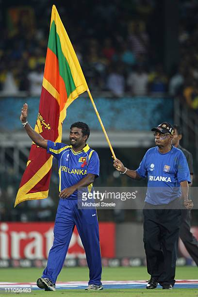 Muttiah Muralitharan of Sri Lanka waves to the crowd after his last match on home soil and his sides five wicket victory during the 2011 ICC World...