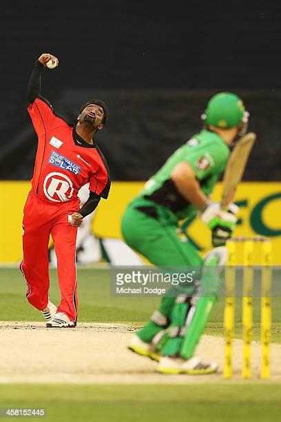 Muttiah Muralitharan of the Renegades bowls during the Big Bash League match between the Melbourne Stars and the Melbourne Renegades at Melbourne...
