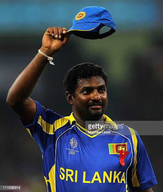 Muttiah Muralitharan salutes the crowd after his last game in Sri Lanka during the 2011 ICC World Cup SemiFinal match between New Zealand and Sri...