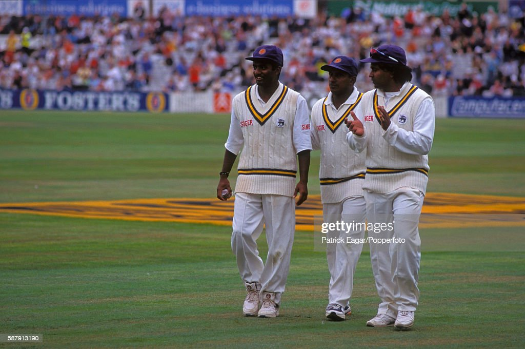 Muttiah Muralitharan Sanath Jayasuriya and Arjuna Ranatunga walk off the pitch at the end of England's second innings of the Only Test match between...