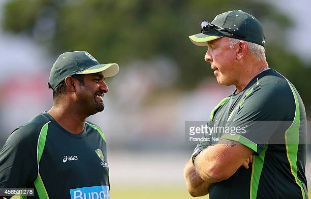Muttiah Muralitharan shares a light moment with Craig McDermott during the Australian training session at the ICC Academy on October 2 2014 in Dubai...