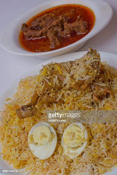 Mutton Curry And Chicken Biryani With Boiled Egg Served In Plate