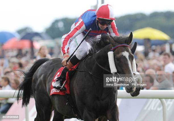 Mutual Regard ridden by Louis Steward wins the Betfred Ebor on Betfred Ebor Day during Day Four of the 2014 Welcome To Yorkshire Ebor Festival at...