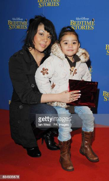 Mutya Buena and her daughter Tahlia arrive at the premiere of Bedtime Stories at the Odeon cinema in Kensington central London