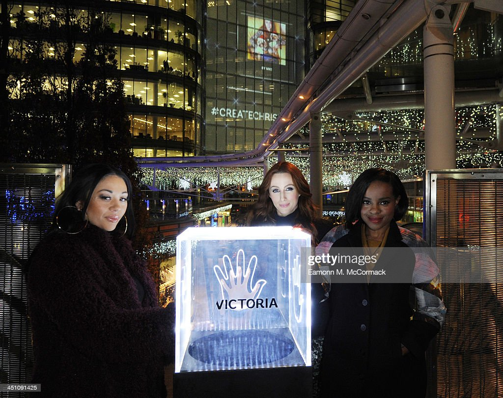 Mutya Buena, Siobhan Donaghy and Keisha Buchanan of the Original Sugababes Mutya Keisha Siobhan (MKS) officially switched on Victoria's lights and launch the 90ft outdoor #CreateChristmas photography exhibition at Cardinal Place on November 21, 2013 in London, England.