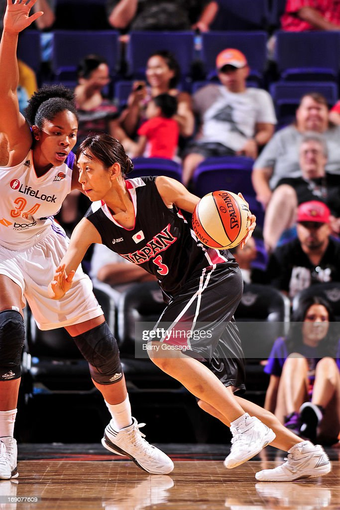 Mutya Mori #5 of the Japanese National Team drives against Krystal Thomas #34 of the Phoenix Mercury during a WNBA preseason game on May 19, 2013 at U.S. Airways Center in Phoenix, Arizona.