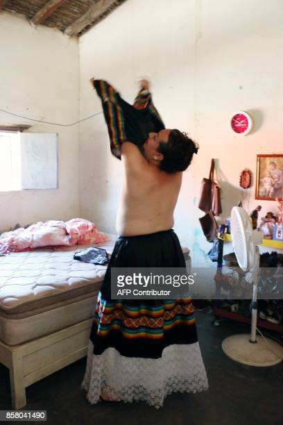 'Muxe' Biniza Carrillo sexual diversity activist gets dressed at her home in the Juchitan community in Oaxaca State Mexico on July 26 2017 Muxes have...