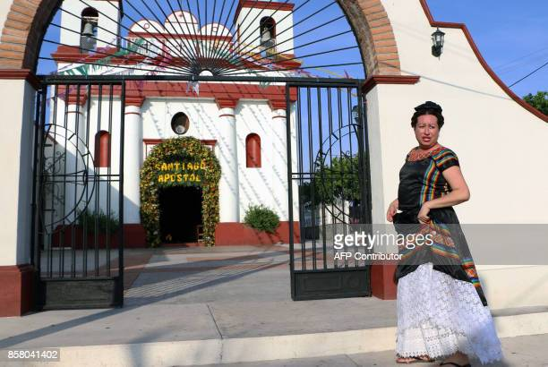 'Muxe' Biniza Carrillo sexual diversity activist stands in front of a parsh church at the Juchitan community in Oaxaca State Mexico on July 26 2017...