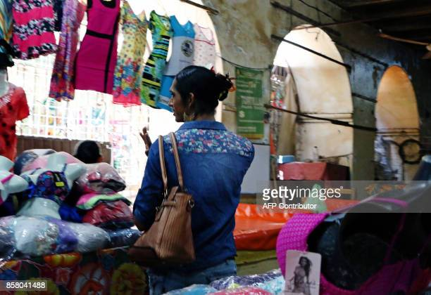 'Muxe' Estrella Vasquez walks through a market at the Juchitan community in Oaxaca State Mexico on July 26 2017 Muxes have been emboldened by the...
