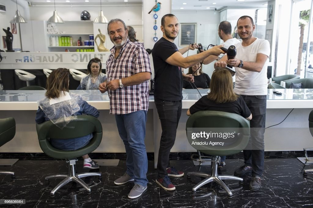 Muzaffer Tunc (62), a hairdresser poses for a photo with his 36-year-old son Timur (R) and 33-year-old son Tolga (C), who had chosen the same field of profession with their father following his lead, in Ankara, Turkey on June 16, 2017. Fathers, sometimes shape the future of their children directing their career and profession choices.