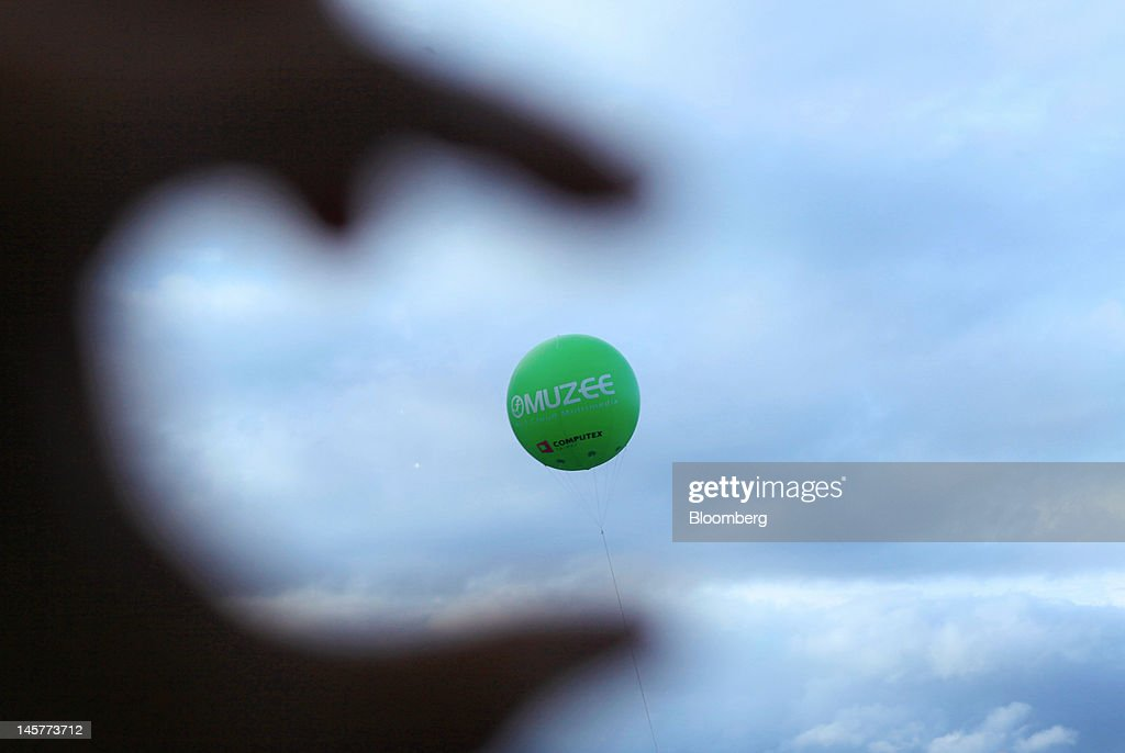 A Muzee Corp. balloon flys outside the Computex Taipei 2012 expo in Taipei, Taiwan, on Tuesday, June 5, 2012. Computex Taipei 2012 takes place from June 5 to June 9. Photographer: Ashley Pon/Bloomberg via Getty Images