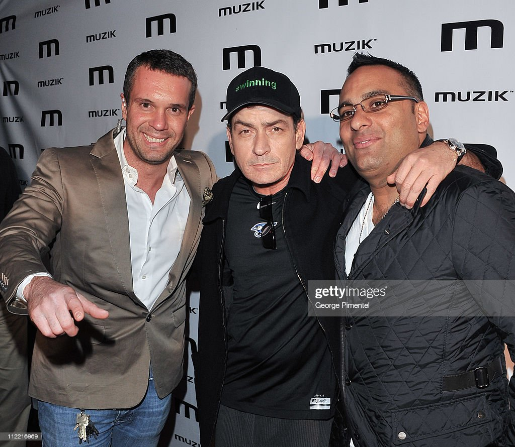 Muzik Manager Zlatko Starkovski, Charlie Sheen and Russell Peters attends the official after-party for his 'Torpedo of Truth' tour at Muzik on April 14, 2011 in Toronto, Canada.